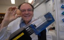 Colin Raston with the Vortex Fluidic Device - also called the 'unboil an egg' machine