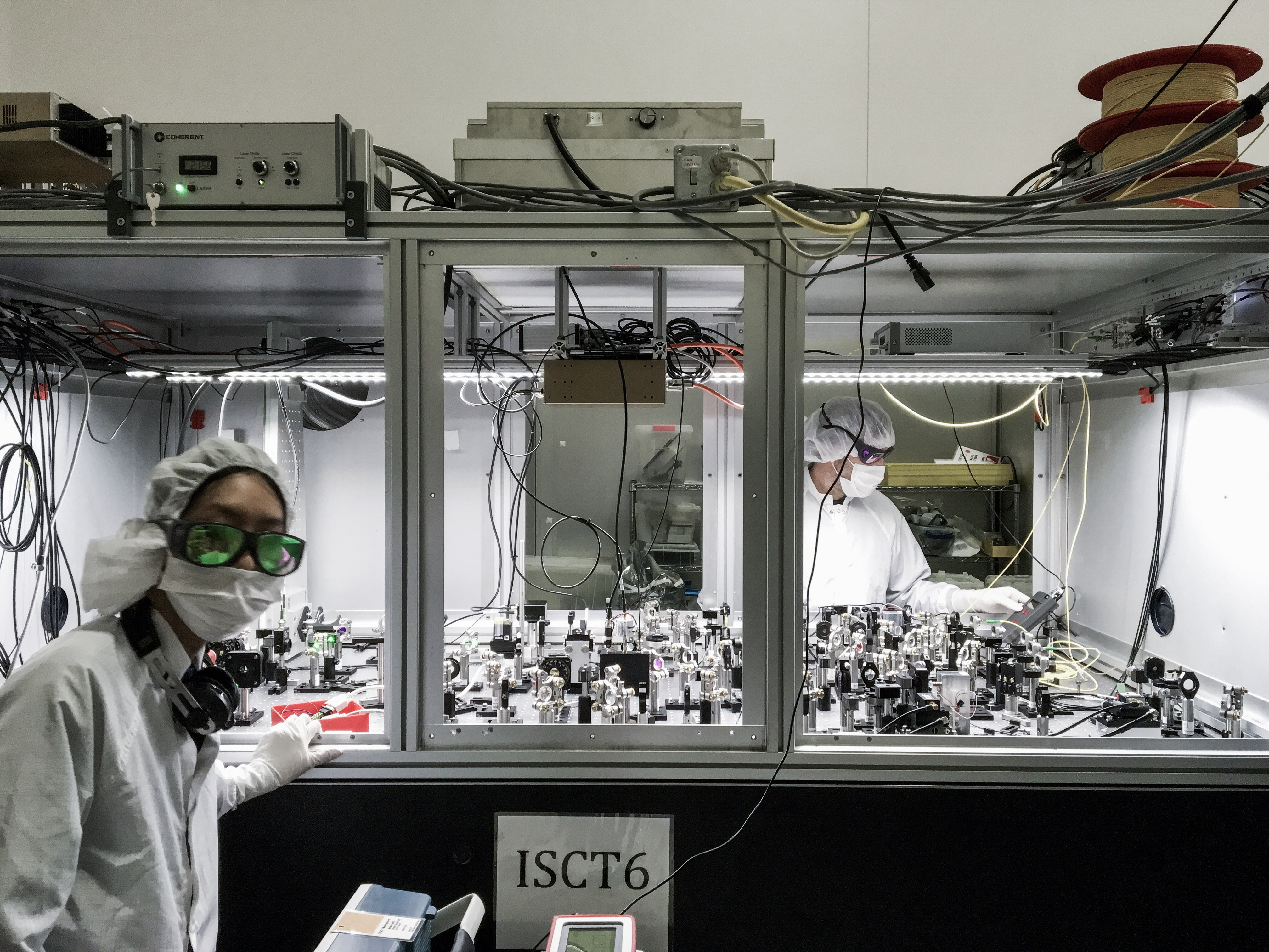 ANU PhD student Nutsinee Kijbunchoo (left) and postdoc Terry McRae (right) building one of the squeezer tables at LIGO Hanford. Credit: Nutsinee Kijbunchoo, ANU