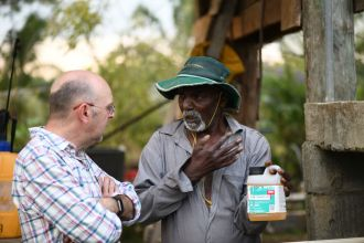 Talking with a farmer in Fiji about the problems associated with using pesticide