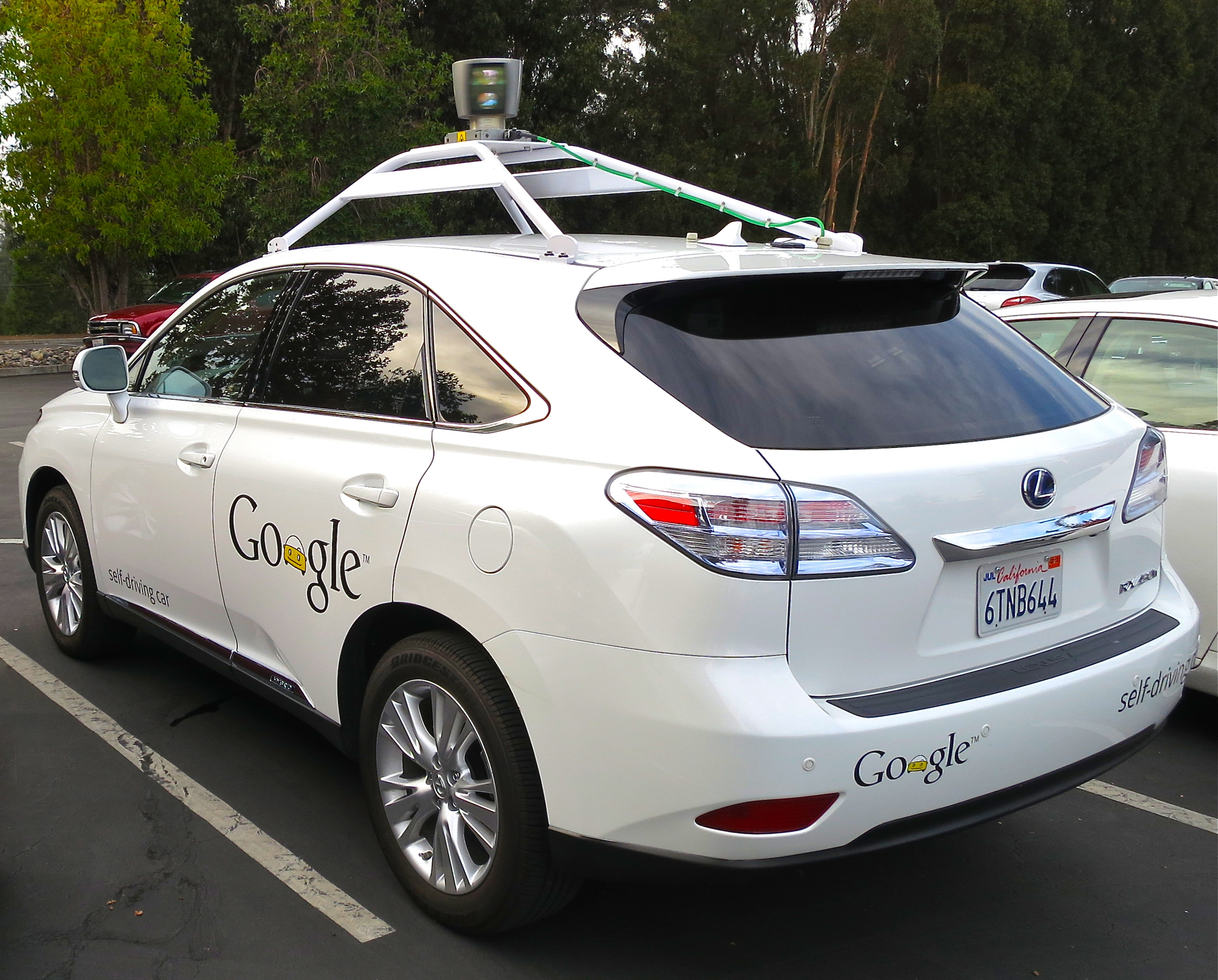 """""""Google's Lexus RX 450h Self-Driving Car"""" by Driving_Google_Self-Driving_Car.jpg: Steve Jurvetsonderivative work: Mariordo - This file was derived fromDriving Google Self-Driving Car.jpg:. Licensed under CC BY 2.0 via Wikimedia Commons - https://commons.wikimedia.org/wiki/File:Google%27s_Lexus_RX_450h_Self-Driving_Car.jpg#/media/File:Google%27s_Lexus_RX_450h_Self-Driving_Car.jpg"""