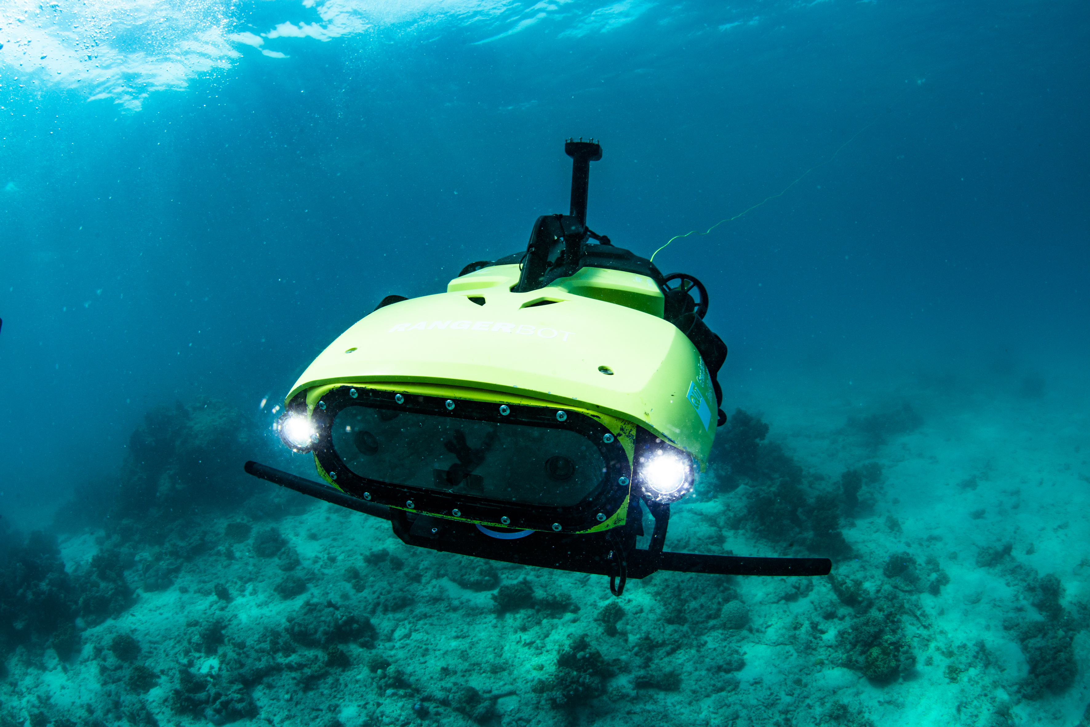 LarvalBot in action. Photo credit: Great Barrier Reef Foundation/Gary Cranitch/Queensland Museum