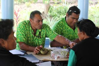 "Farmers receive advice from a ""plant doctor"" at a plant health clinic in Samoa."