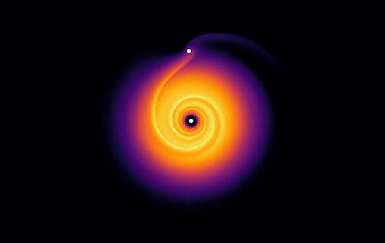 Computer model showing the spiral pattern generated by a newborn planet orbiting in a disc of gas around a young star. Credit: Pinte et al 2018.