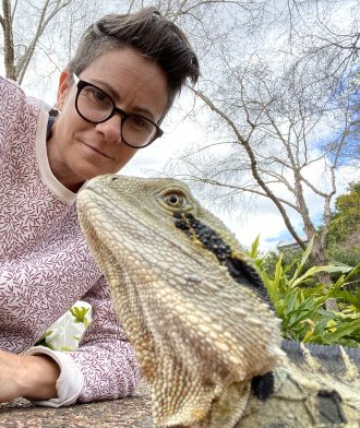 Associate Professor Celine Frere with a water dragon.