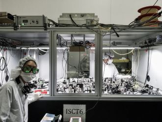 OzGrav researchers building one of the squeezer tables at LIGO