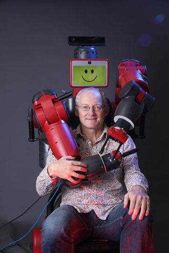 Prof Toby Walsh with a Baxter robot